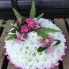 A Cushion of Chrysanthemums with Roses and Orchids