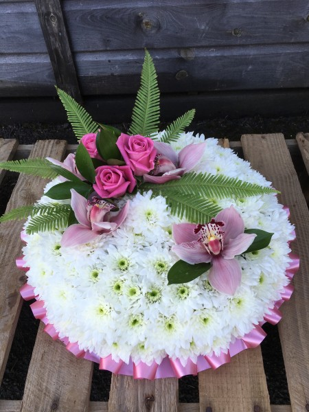 A Cushion of Chrysanthemums with Roses and Orchids -